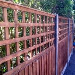 ndian sandstone close board fence with trellis and weed free turf